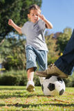 Boy kicking the football Royalty Free Stock Images
