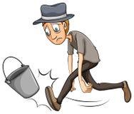 A boy kicking the pail Royalty Free Stock Photos