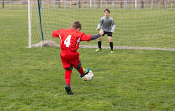 Little Boy Shooting at Goal Royalty Free Stock Photo
