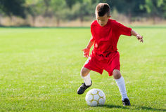 Free Boy Kicking Soccer Ball Stock Images - 78375934
