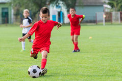 Free Boy Kicking Soccer Ball Royalty Free Stock Images - 84842829