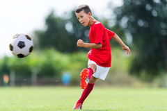 Free Boy Kicking Soccer Ball Stock Images - 84866654