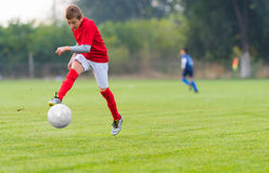 Free Boy Kicking Soccer Ball Royalty Free Stock Images - 85330169