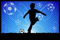 Boy kicking soccer ball on the abstract background