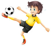 A boy kicking the soccer ball Royalty Free Stock Image
