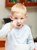 Boy kid child eating corn flakes breakfast meal Stock Images