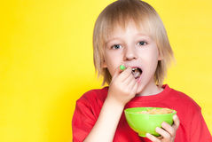 Boy kid child eating corn flakes cereal Royalty Free Stock Image