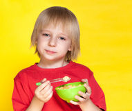 Boy kid child eating corn flakes cereal Stock Photography