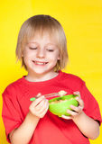 Boy kid child eating corn flakes cereal Royalty Free Stock Images