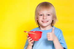 Boy kid child eating corn flakes cereal. Blond boy kid child eating corn flakes cereal stock photo