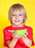 Boy kid child eating corn flakes cereal. Blond boy kid child eating corn flakes cereal stock images