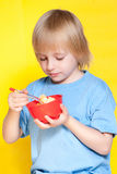 Boy kid child eating corn flakes cereal. Blond boy kid child eating corn flakes cereal stock image