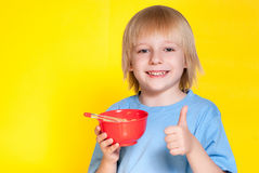 Boy kid child eating corn flakes cereal. Blond boy kid child eating corn flakes cereal royalty free stock images