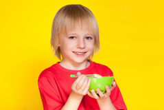 Boy kid child eating corn flakes cereal. Blond boy kid child eating corn flakes cereal royalty free stock photography