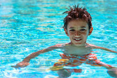 Boy kid child eight years old inside swimming pool portrait happy fun bright day Royalty Free Stock Photos
