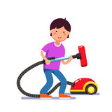 Boy kid holding electric vacuum cleaner pipe Stock Photo