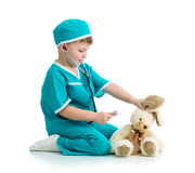 Child playing doctor with toy Royalty Free Stock Photography
