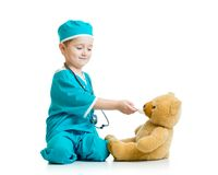 Boy kid playing doctor with toy Royalty Free Stock Photo