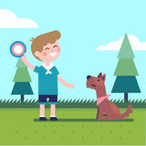 Boy kid playing flying disk trow catch with a dog Stock Photography