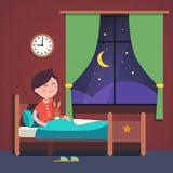 Boy kid preparing to sleep bedtime in his bed Royalty Free Stock Image