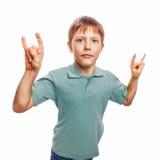 Boy kid teenager shows gesture hands metal rock Stock Photo