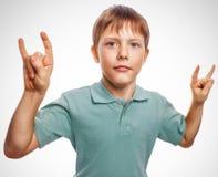 Boy kid teenager shows gesture hands metal rock Stock Images