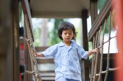 Boy in uniform school playing in playground royalty free stock photography