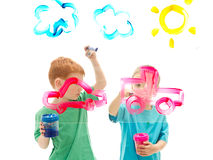 Boy kids painting art on glass. Boys painting art pictures on glass.  on white Stock Images