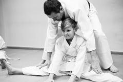 A boy in kimono begin training on aikido. royalty free stock photography