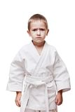 Boy in kimono training karate Stock Photo