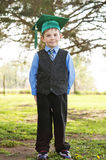 Boy Kindergarten in suit tie cap and tassel Stock Images
