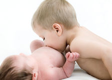 Boy kiss her newborn sister Royalty Free Stock Image
