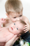 Boy kiss her newborn sister. Little boy kiss her newborn sister Royalty Free Stock Image