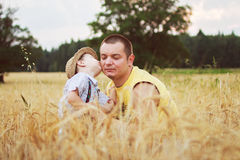 Boy kiss his father in the field. Happy family Royalty Free Stock Photography