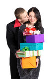 Boy kisses the girl, holding a box of gifts Royalty Free Stock Photography