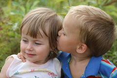 Boy kisses girl. Little boy kissing his little sister Royalty Free Stock Photography