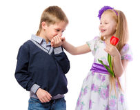 The boy kisses the hand of the girl Stock Image