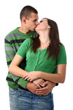 Boy kisses and hugs girlfriend isolated on white royalty free stock photos