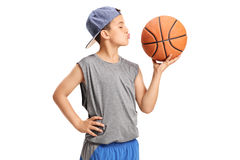 Boy kissing a basketball. Isolated on white background Royalty Free Stock Photography
