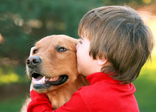 Boy Kissing Dog Royalty Free Stock Photos