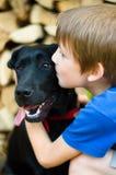 Boy Kissing Dog Royalty Free Stock Photography