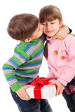 Boy kissing a girl holding gift box Royalty Free Stock Photography