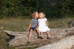 Boy kissing a girl Stock Photo