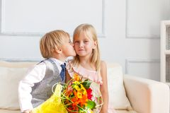 Boy is kissing girl. Stock Photography