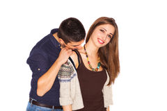 Boy kissing girlfriend's shoulder Royalty Free Stock Photography