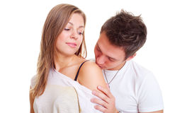 Boy kissing his girl in shoulder Stock Image