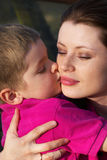 Boy kissing his mother Royalty Free Stock Photos