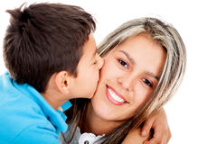 Boy kissing his mother Royalty Free Stock Image