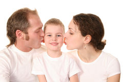 Boy with kissing parents Royalty Free Stock Images