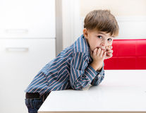 The boy in the kitchen.  Royalty Free Stock Images